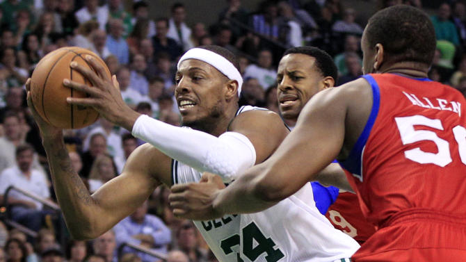 Boston Celtics forward Paul Pierce (34) drives through the defense of Philadelphia 76ers forwards Lavoy Allen (50) and forward Andre Iguodala during the second quarter of Game 7 in an NBA basketball Eastern Conference semifinal playoff series, Saturday, May 26, 2012, in Boston. (AP Photo/Elise Amendola)
