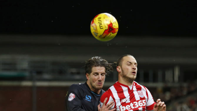 Sheffield Wednesday's Sam Hutchinson in action with Stoke's Marko Arnautovic