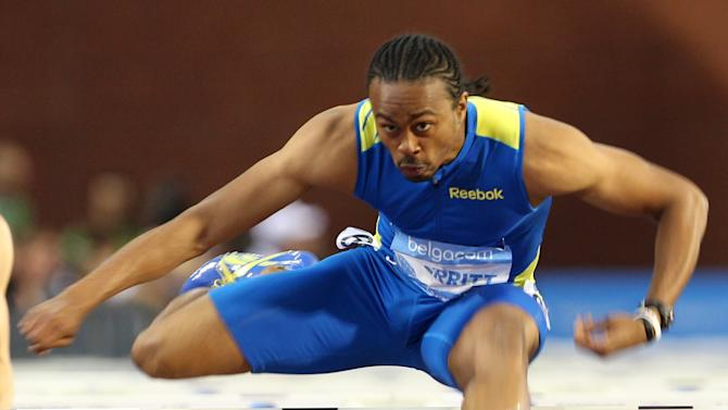 US athlete Aries Merritt wins the 110 meters hurdles and sets a new world record of 12.80, at the Diamond League Memorial Van Damme athletics event at Brussels' King Baudouin Stadium, Friday, Sept. 7, 2012. (AP Photo/Yves Logghe)