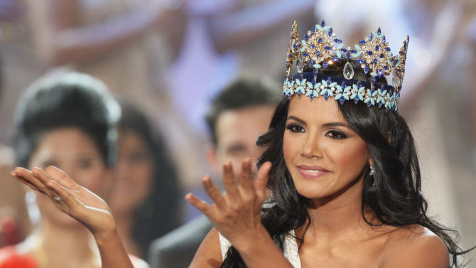 Miss Venezuela Ivian Sarcos reacts as she is crowned winner at the Miss World competition held at Earls Court in London, Sunday, Nov. 6, 2011. (AP Photo/Kirsty Wigglesworth)