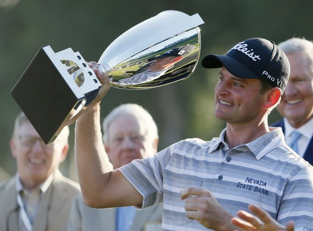 John Merrick of the U.S. celebrates with his trophy after winning the Northern Trust Open golf tournament in Los Angeles