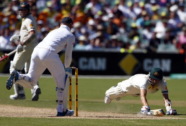 Australia's Lyon dives to make his ground as England's Prior attempts to run him out during the second day's play in the second Ashes cricket test at the Adelaide Oval