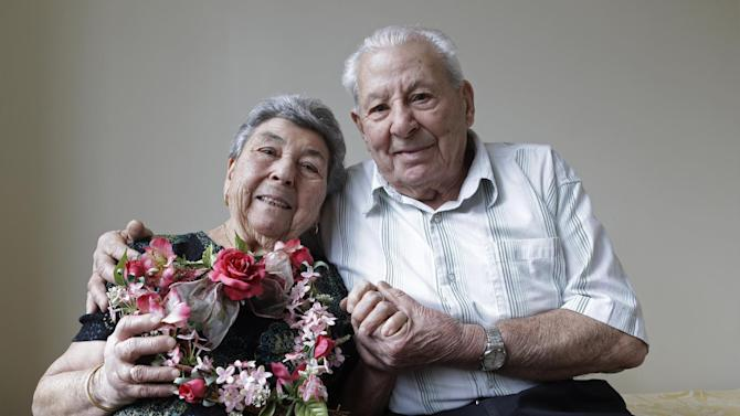 Madalena, 88, and Fortunato Corso, 89, a Bensonhurst couple married 72 years who met in Calabria, Italy, and married on Feb. 4, 1941, pose for a photograph at their home in New York, Wednesday, Feb. 13, 2013.  On Thursday they'll be honored by Brooklyn borough President Marty Markowitz in a celebration of couples married 50 years or more.  The Corso's, who met as teenagers in Calabria, Italy, and married Feb. 4, 1941, have seven children, three girls and four boys. (AP Photo/Kathy Willens)