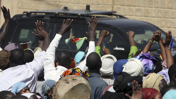 French President Francois Hollande visits Timbuktu, Mali, Saturday Feb. 2, 2013, making a triumphant stop six days after French forces parachuted into Timbuktu to liberate the fabled city from the radical Islamists occupying it.. (AP Photo/Harouna Traore)