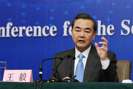China's Foreign Minister Wang speaks during a news conference as part of the National People's Congress in Beijing