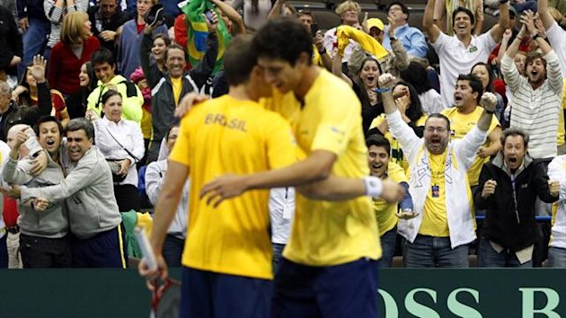 DATE IMPORTED:February 2, 2013Brazil's Bruno Soares (L) and Marcelo Melo (R) embrace as fans celebrate behind them after winning their Davis Cup tennis men's double match against Bob and Mike Bryan of the U.S