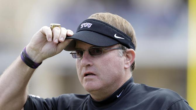 TCU head coach Gary Patterson watches from the sidelines during the first half of an NCAA college football game against Baylor, Saturday, Nov. 30, 2013, in Fort Worth, Texas