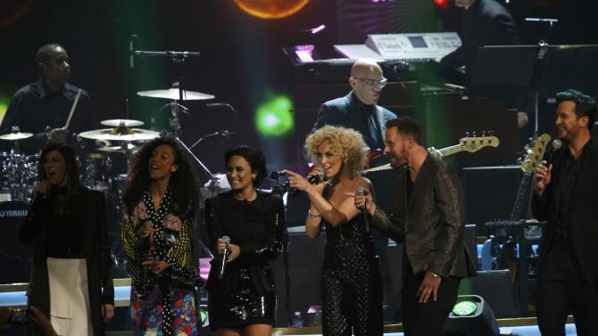Musicians Little Big Town, Rae , Lovato and Bryan perform on stage at the 2016 MusiCares Person of the Year gala in Los Angeles