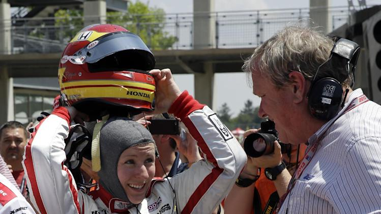 Pippa Mann, of England,   talks with car owner Dale Coyne, right, after she qualified on the second day of qualifications for the Indianapolis 500 auto race at the Indianapolis Motor Speedway in Indianapolis Sunday, May 19, 2013. (AP Photo/Tom Strattman)