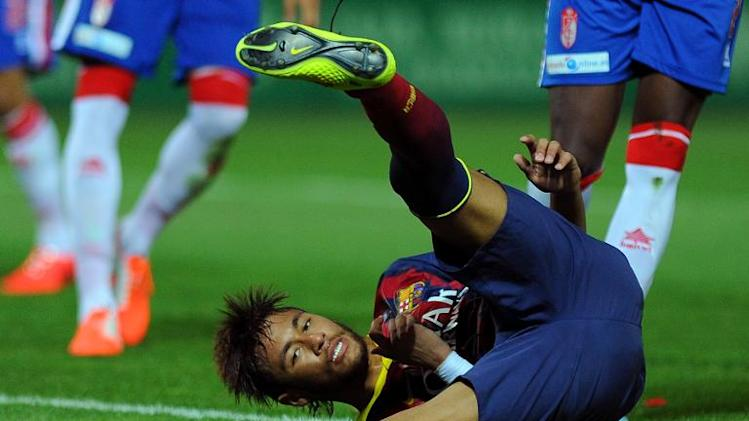 Barcelona's Neymar da Silva Santos Junior takes a tumble during Barca's 1-0 Spanish league defeat to Granada at the Nuevo Los Carmenes stadium on April 12, 2014