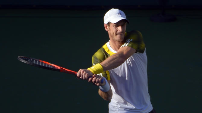 Andy Murray, of Great Britain, returns a shot to Juan Martin del Potro, of Argentina, during their match at the BNP Paribas Open tennis tournament, Friday, March 15, 2013, in Indian Wells, Calif. (AP Photo/Mark J. Terrill)
