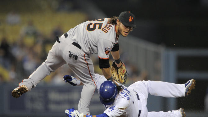 Los Angeles Dodgers' Juan Rivera, right, is forced out at second as San Francisco Giants shortstop Brandon Crawford tries to throw out Jamey Carroll at first during the fifth inning of a baseball game, Thursday, Sept. 22, 2011, in Los Angeles. Carroll was safe at first. (AP Photo/Mark J. Terrill)