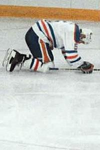 Edmonton Oilers' Steve Smith reacts after scoring into his own net against the Calgary Flames in the 1986 NHL playoffs