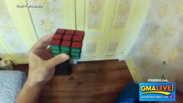 Man Solves Rubik's Cube While Juggling