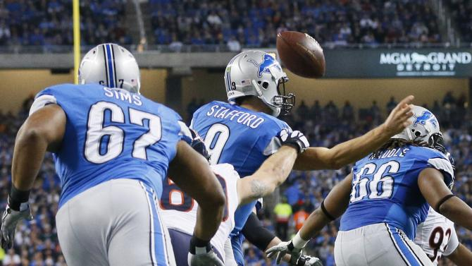 Chicago Bears defensive end Jared Allen jars the ball out of Detroit Lions quarterback Matthew Stafford's control during the first half of an NFL football game in Detroit, Thursday, Nov. 27, 2014. (AP Photo/Rick Osentoski)