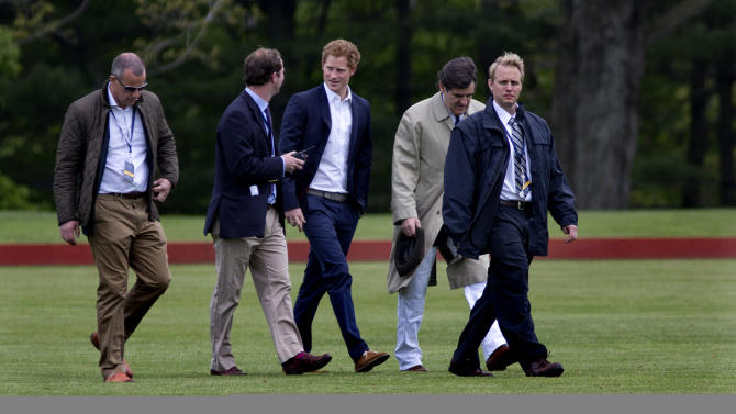 Britain's Prince Harry walks across the polo field before the Sentebale Royal Salute Polo Cup charity match in Greenwich, Conn., Wednesday, 15, 2103. Prince Harry is  is competing at the Greenwich Polo Club to benefit Sentebale, the charity he co-founded to help poor children and AIDS orphans in the small African nation of Lesotho.  (AP Photo/Craig Ruttle)