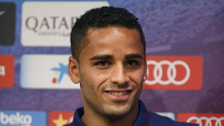 Barcelona's new soccer player Douglas poses with his club jersey during a news conference after his presentation at Nou Camp stadium in Barcelona