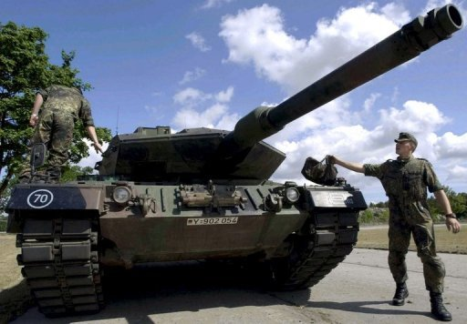 A soldier of the German Bundeswehr walking past a Leopard II A5 tank at a military base in Torgelow, eastern Germany in 2003. Saudi Arabia wants to buy 600-800 Leopard battle tanks from Germany, more than twice as many as originally envisaged, the Sunday newspaper Bild am Sonntag reported