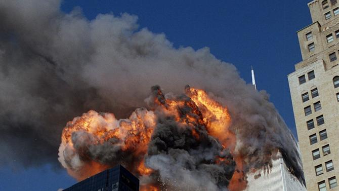 FILE - In this Sept. 11, 2001 file photo, smoke, flames and debris erupt from one of the World Trade Center towers after a plane strikes it, in New York. The first tower was already burning following a similar attack minutes earlier. Osama bin Laden, the glowering mastermind behind the Sept. 11, 2001, terror attacks that killed thousands of Americans, was slain in his luxury hideout in Pakistan early Monday, May 2, 2011 in a firefight with U.S. forces, ending a manhunt that spanned a frustrating decade. (AP Photo/Chao Soi Cheong, File) MANDATORY CREDIT