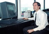 FILE - In this April 4, 1991, file photo, Steve Jobs of NeXT Computer Inc. poses for the press with his NeXTstation color computer at the NeXT facility in Redwood City, Calif. FBI background interviews of some people who knew Jobs, who founded Apple in the 1970s, reveal a man so driven by power that he sometimes lost sight of honesty. The newly released FBI interviews conducted in 1991 were part of a background check for an appointment to the President's Export Council during George H.W. Bush's administration. (AP Photo/Ben Margot, File)