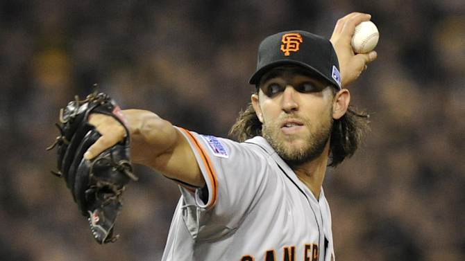 San Francisco Giants starting pitcher Madison Bumgarner throws against the Pittsburgh Pirates in the second inning of the NL wild-card playoff baseball game on Wednesday, Oct. 1, 2014, in Pittsburgh. (AP Photo/Don Wright)