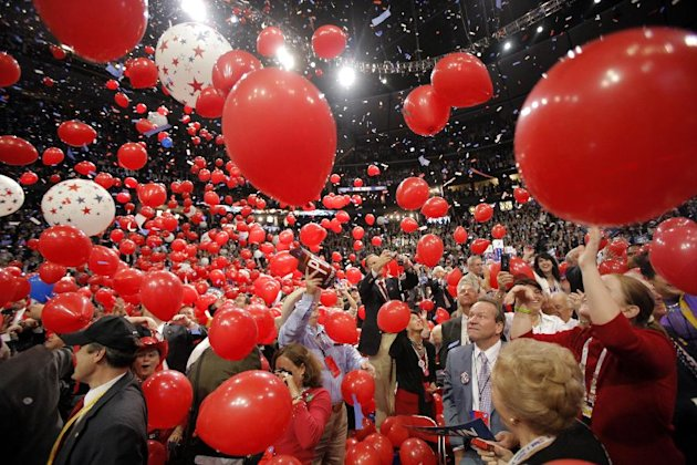 In this Sept. 4, 2008, photo, balloons fall on the floor as Republican presidential nominee John McCain is joined by his wife, Cindy, his family and his running mate, Sarah Palin, and her family, not