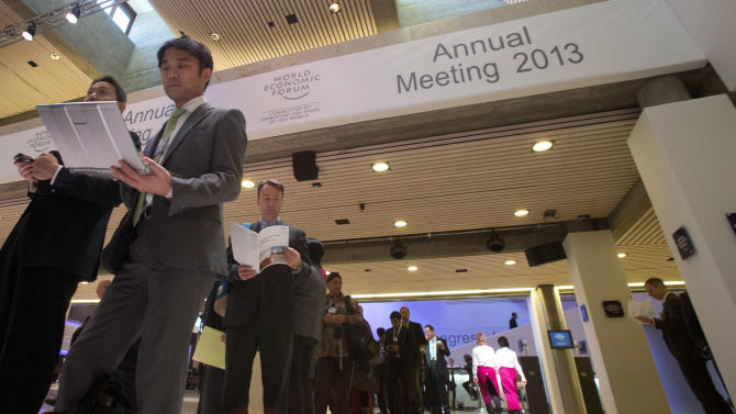 Participants lining up for a panel session at 43rd Annual Meeting of the World Economic Forum, WEF, takes place in Davos, Switzerland, Saturday, Jan. 26, 2013. (AP Photo/Michel Euler)