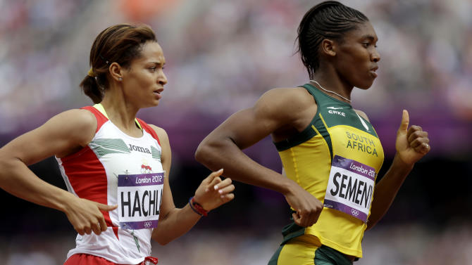 South Africa's Caster Semenya leads Mauritius' Annabelle Lascar in a women's 800-meter heat during the athletics in the Olympic Stadium at the 2012 Summer Olympics, London, Wednesday, Aug. 8, 2012. (AP Photo/Anja Niedringhaus)