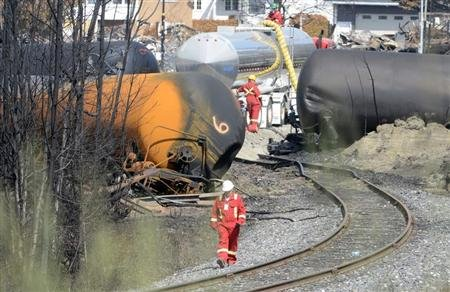 A worker walks near the railway track on the site of the train wreck in Lac Megantic