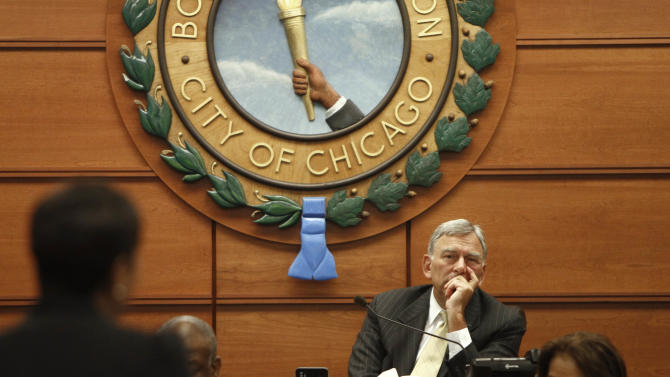 Chicago Board of Education President David Vitale listens to a presentation at a Chicago Board of Education meeting on Wednesday, Aug. 22, 2012 in Chicago. (AP Photo/Sitthixay Ditthavong)