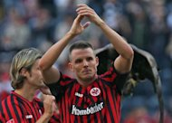 Frankfurt&#39;s midfielder Alexander Meier celebrates after the German first division Bundesliga football match Eintracht Frankfurt vs SC Freiburg the western German city of Moenchengladbach. Frankfurt won the match 2-1