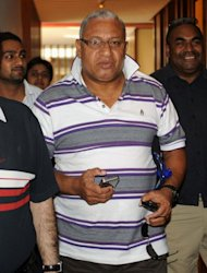 "Fiji Prime Minister Voreqe Bainimarama (C) in the Indian city of Amritsar on April 27, 2012. He has warned the storm is an ""impending disaster"" and offers of international aid have already been received"