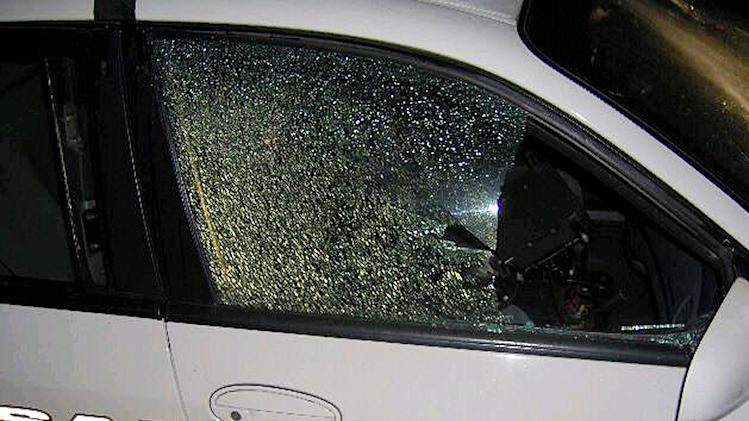 This photo provided by the Sanford Police Department shows a police cruiser Tuesday, April 10, 2012, after it was shot in Sanford, Fla. Authorities say gunfire knocked out a window on the car parked near the townhome community in Florida where unarmed black teen Trayvon Martin was shot to death by a neighborhood watch volunteer. Sanford police told Orlando television station WKMG the cruiser was found with at least two bullet holes Tuesday morning after witnesses reported hearing at least six gunshots. (AP photo/Sanford Police Department)