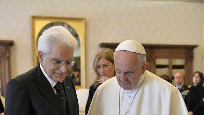 Pope Francis talks with Italy's President Mattarella during a private audience in the pontiff's studio at the Vatican