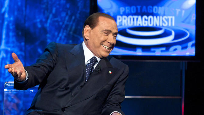 Former Italian Premier Silvio Berlusconi attends a TV show in Rome, Sunday, Dec. 23, 2012. Italy's caretaker Premier Mario Monti on Sunday said is spurning he won't take up Silvio Berlusconi's offer to run on a center-right election ticket backed the by media mogul, citing Berlusconi's heavy criticism of his economic policies. (AP Photo/Roberto Monaldo, Lapresse)