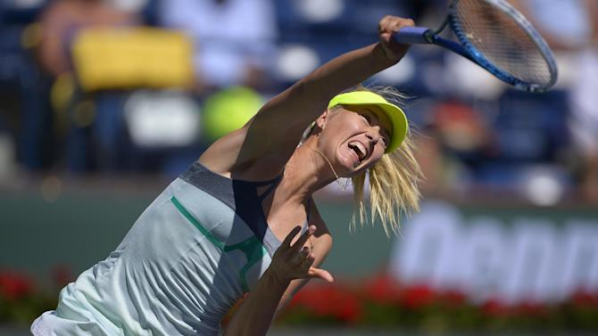 Maria Sharapova, of Russia, serves against Lara Arruabarrena-Vecino, of Spain, during their match at the BNP Paribas Open tennis tournament, Tuesday, March 12, 2013, in Indian Wells, Calif. (AP Photo/Mark J. Terrill)