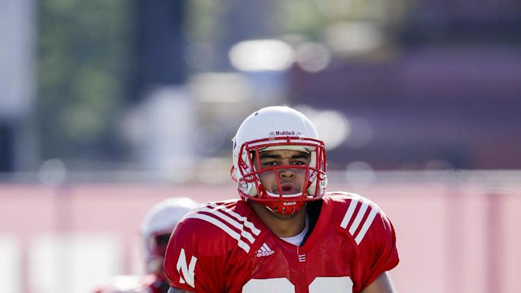 In this Aug. 13, 2014, photo, Nebraska defensive tackle Kevin Williams (92) warms up during the NCAA college football team's practice in Lincoln, Neb. Williams, who has had two major knee surgeries, went down Monday, Aug. 18, 2014. Nebraska coach Bo Pelini said Williams was day-to-day with an ankle injury