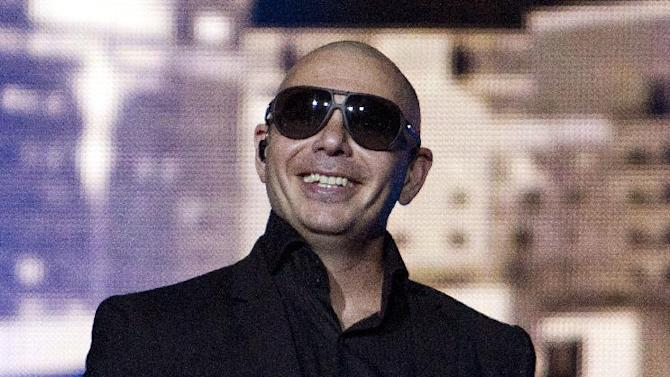 American rapper Pitbull performed as part of his co-headlining tour with Enrique Iglesias at The Arena at Gwinnett Center on Wednesday, October 22, 2014, in Duluth, Ga. (Photo by Dan Harr/Invision/AP)