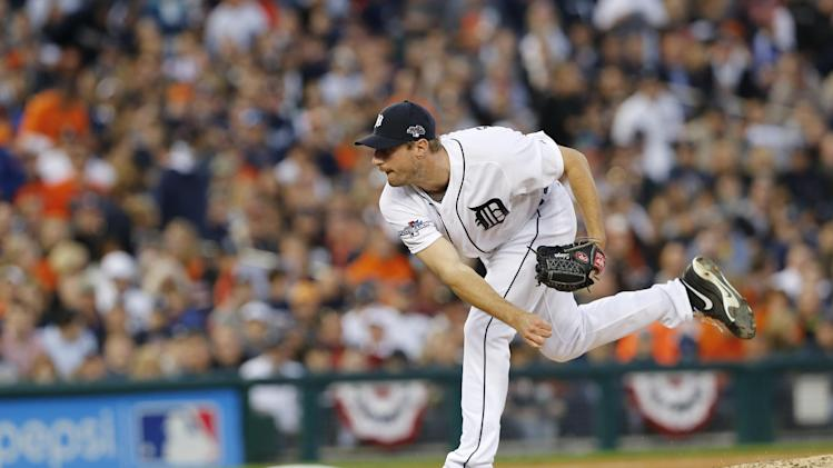Detroit Tigers pitcher Max Scherzer follows through during the seventh inning of Game 4 of baseball's American League division series against the Oakland Athletics in Detroit, Tuesday, Oct. 8, 2013. (AP Photo/Paul Sancya)
