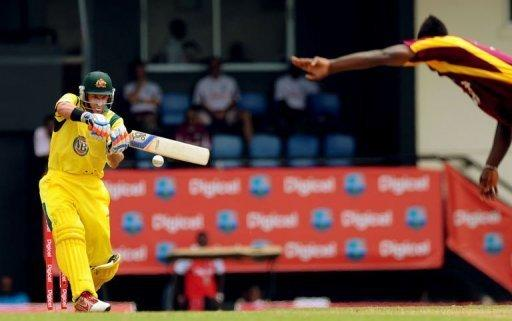 Australian cricketer Mike Hussey plays a shot