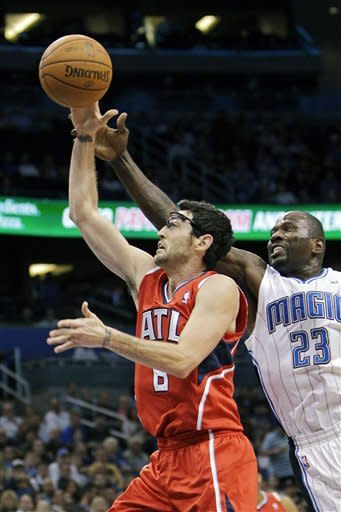 Smith scores 23 as Hawks slip past Magic in OT