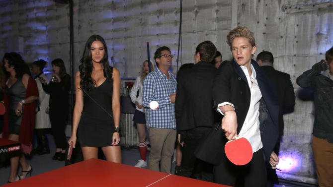 Jessica Green and Cody Simpson play ping pong at the 16th Annual Friends 'N' Family Pre-Grammy Party at Paramount Studios on Friday, Feb. 8, 2013 in Los Angeles. (Photo by Todd Williamson/Invision/AP)