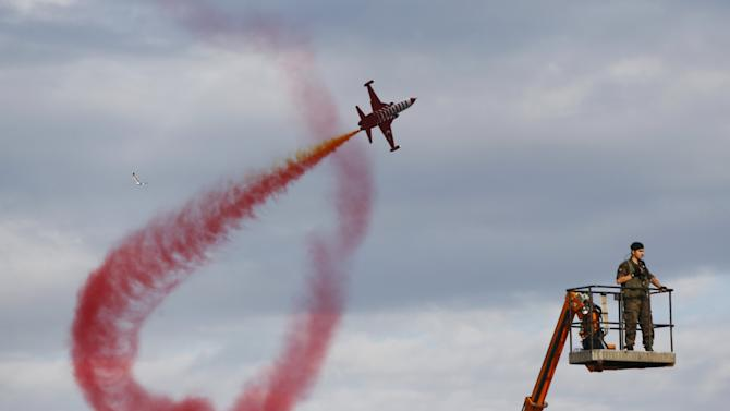 Turkish Stars, the aerobatic team of the Turkish Air Force, perform during a ceremony to mark the 562nd anniversary of the conquest of the city by Ottoman Turks, in Istanbul