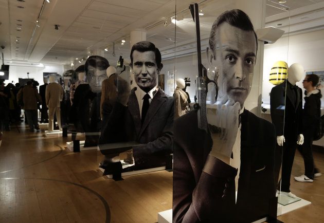 A general view of the James Bond movie memorabilia charity auction at Christie's auction house during the press pre-view showing large portraits of the actors who have portrayed the famous movie icon