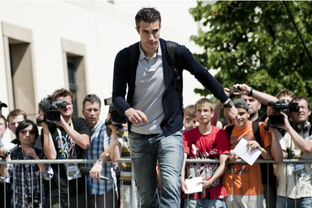 The Netherlands' National Football Team Player Robin Van Persie Leaves The Sheraton Hotel In Krakow On June 18, 2012. AFP/Getty Images