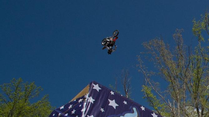 29 yr-old Nitro Circus athlete Josh Sheehan completes the world's first triple back flip on an FMX motor bike at Pastranaland on Tuesday, April 28, 2015 in Davidsonville, Md.  Sheehan broke the double backflip record set in 2006 by Nitro Circus co-founder Travis Pastrana who was also on hand to witness the event.    (Nick Wass/AP Images for Nitro Circus)