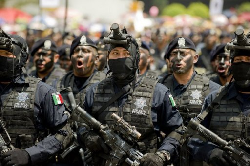 Mexican Federal Police members march along Juarez Avenue in Mexico City on September 16, 2012. Mexican President Enrique Pena Nieto announced the creation of a national police force to crack down on crime and battle the country's powerful drug cartels.