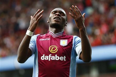Aston Villa's Benteke reacts after missing a chance to score during their English Premier League soccer match against Liverpool in Birmingham
