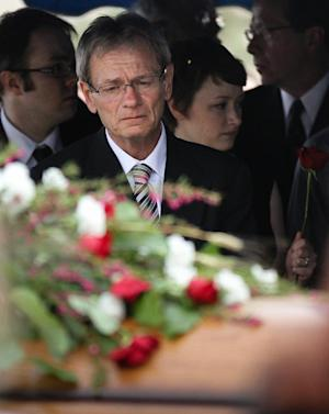 Gary Arnold looks at the casket during the funeral service for his late wide, Sherry Arnold, in Sidney, Mont. on Friday, March 30, 2012. Arnold, a high school teacher, was kidnapped and murdered after disappearing in January. (AP Photo/Williston Herald, Elijah Nouvelage)