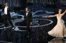 Host Seth MacFarlane peforms a dance with Channing Tatun and Charlize Theron at the 85th Academy Awards in Hollywood